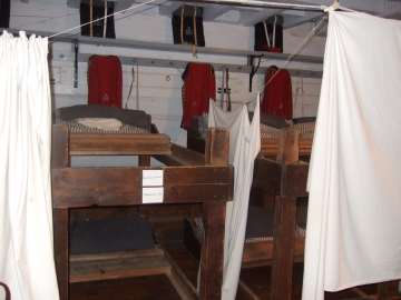 Hanging blankets provided a family's only privacy.  Children slept wherever they could find a spot.  Wives and children were expected to work.