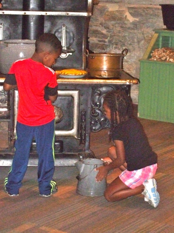 These kids got into the spirit by pretending to cook for the threshing crew.