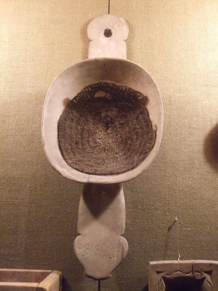 A milk strainer as it would have been used.