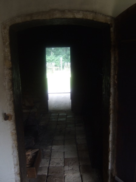 This photo was taken inside the black kitchen, looking back at the front door.