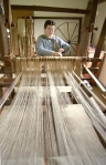 An interpreter weaves on the loom at the Schulz (German)farm.