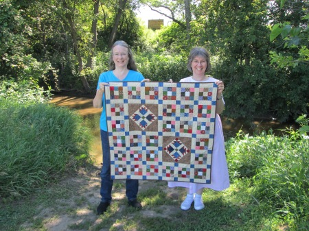 Linda (on the right) and I took the gorgeous quilt she made for me to the Ingalls family's dugout site on Plum Creek (small sign in the background marks actual spot). Just because.