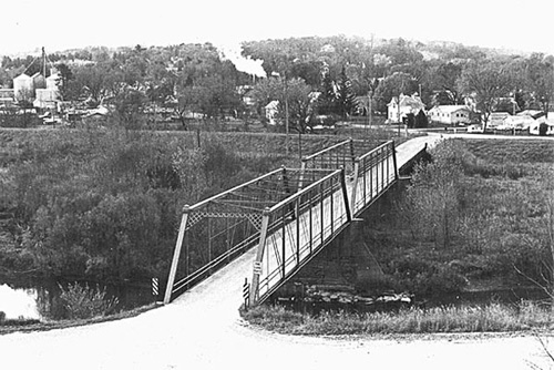 Black and white photo of the Fifth Street Twin Spans bridge over the Upper Iowa River on the northeast side of Decorah Iowa. Photo courtesy of the Winneshiek County Historical Society.
