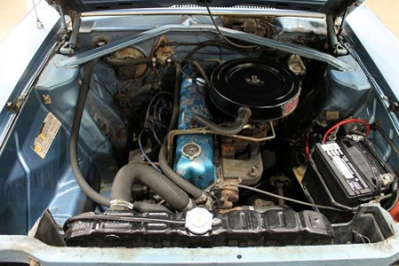 Photo of six cylinder engine compartment of 1969 AMC Rambler. Image by GR Auto Gallery.