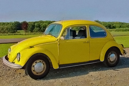 Photo of a yellow 1969 VW Beetle.