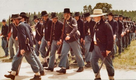 Company formation of Union Infantry reenactors marching in column at Old World Wisconsin in the 1980s. Photo courtesy of John Wedeward.