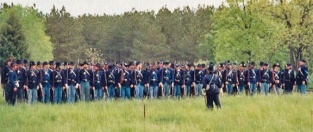 A long double rank of Union Army Infantry at Old World Wisconsin. Photo by Kathleen Ernst.